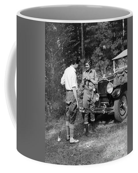 1920s Coffee Mug featuring the photograph Man And Woman In Fishing Gear by H. Armstrong Roberts/ClassicStock