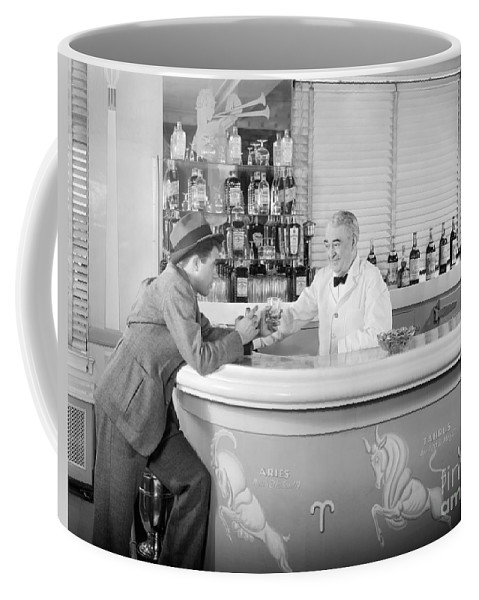 1930s Coffee Mug featuring the photograph Man Ordering Another Drink, C. 1940s by H. Armstrong Roberts/ClassicStock