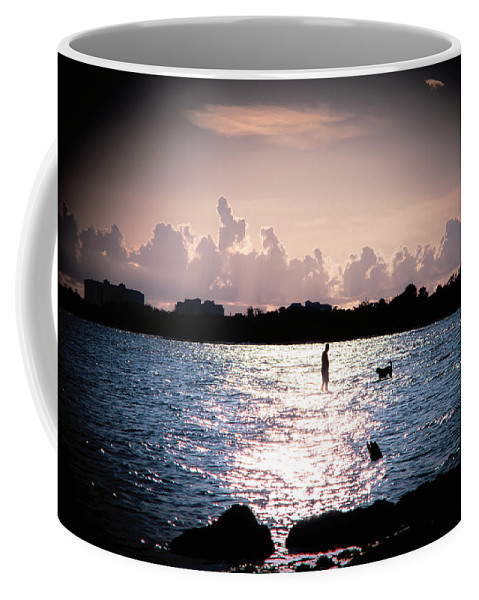 Beach Play Coffee Mug featuring the photograph Man's Best Friend by Michael Frizzell