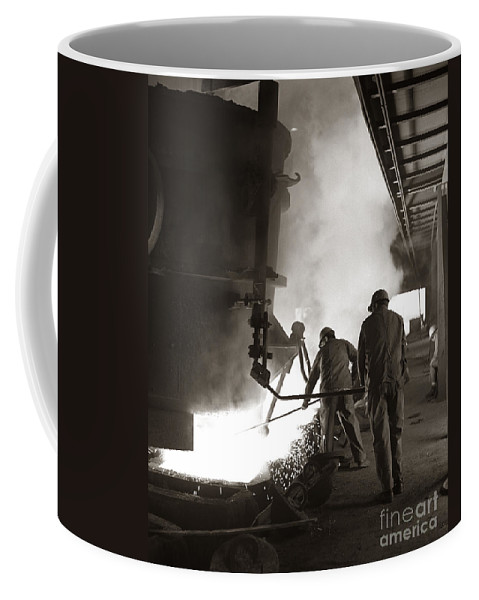 1960s Coffee Mug featuring the photograph Men Working Blast Furnace At Steel by H. Armstrong Roberts/ClassicStock