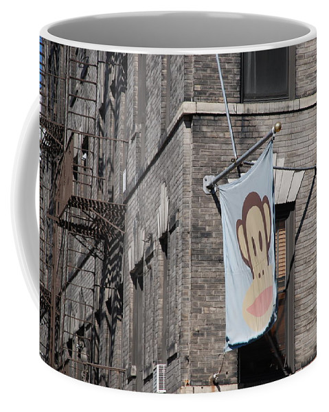 Street Scene Coffee Mug featuring the photograph Monkey Flag by Rob Hans