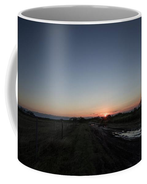 Port Isabel Coffee Mug featuring the photograph Muddy Road Sunrise by JG Thompson
