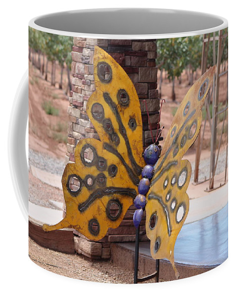 Metal Sculpture Coffee Mug featuring the photograph Mustard Yellow Metal Sculpture of Butterfly by Colleen Cornelius