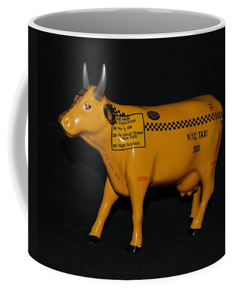 Macro Coffee Mug featuring the photograph N Y C Taxi Cow by Rob Hans
