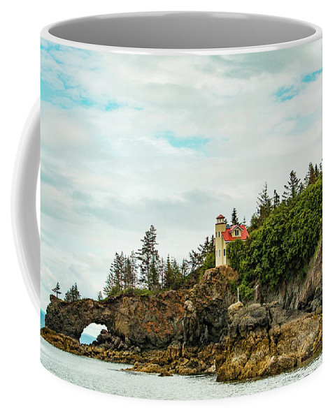 Alaska Coffee Mug featuring the photograph Natural Arch At Lighthouse Point by Edie Ann Mendenhall