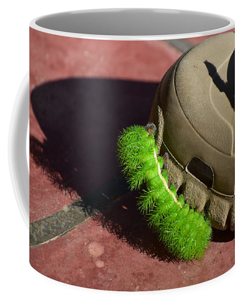 Bright Coffee Mug featuring the photograph Neon Geen Caterpillar Loves Crocs by Sabine Greger