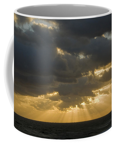 Ocean Sunset Sun Cloud Clouds Ray Rays Beam Beams Bright Wave Waves Water Sea Beach Golden Nature Coffee Mug featuring the photograph New Beginning by Andrei Shliakhau