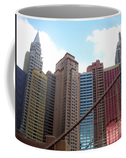 Vegas Coffee Mug featuring the photograph New York Hotel With Clouds by Anita Burgermeister