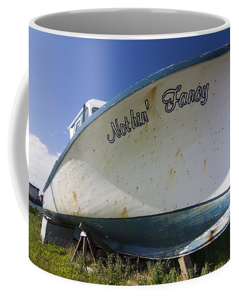 Boat Coffee Mug featuring the photograph Old Dry Docked Boat by Sven Brogren