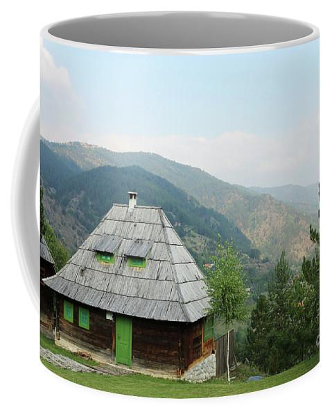 Cabin Coffee Mug featuring the photograph Old Log Cabin On Mountain Landscape by Goce Risteski