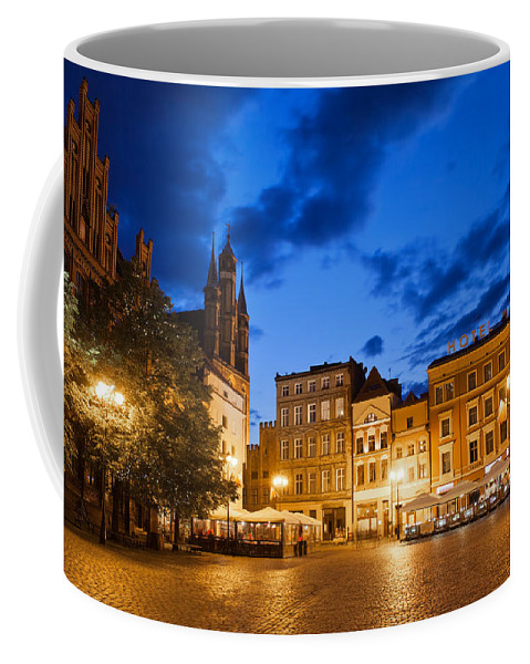 Torun Coffee Mug featuring the photograph Old Town Square By Night In Torun by Artur Bogacki