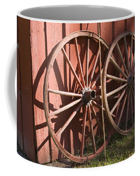 Old Time Antique Wagon Wheel Wood Wooden Red Barn Rural Country Farm Farming Round Coffee Mug featuring the photograph Old Wagon Wheels by Andrei Shliakhau