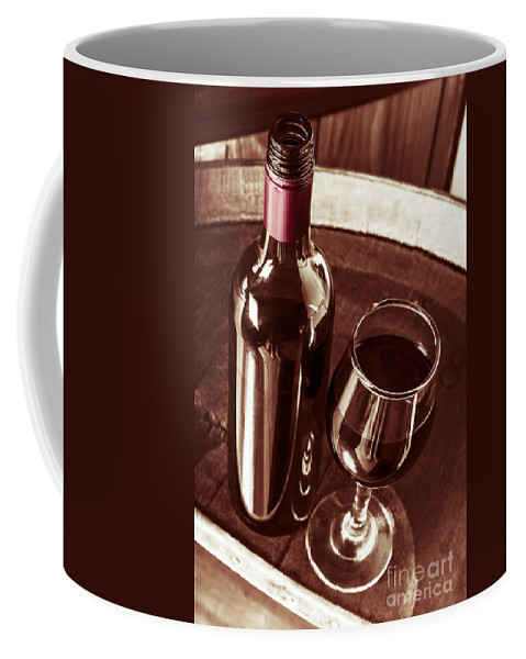 Bottle Coffee Mug featuring the photograph Old Wine Bottle And Glass In Rustic Wine Cellar by Jorgo Photography - Wall Art Gallery