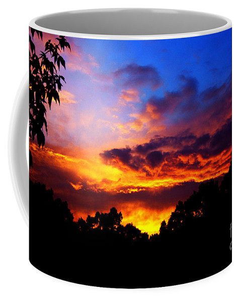 Clay Coffee Mug featuring the photograph Ominous Sunset by Clayton Bruster