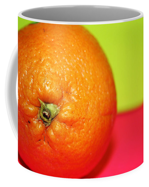 Oranges Coffee Mug featuring the photograph Orange by Linda Sannuti