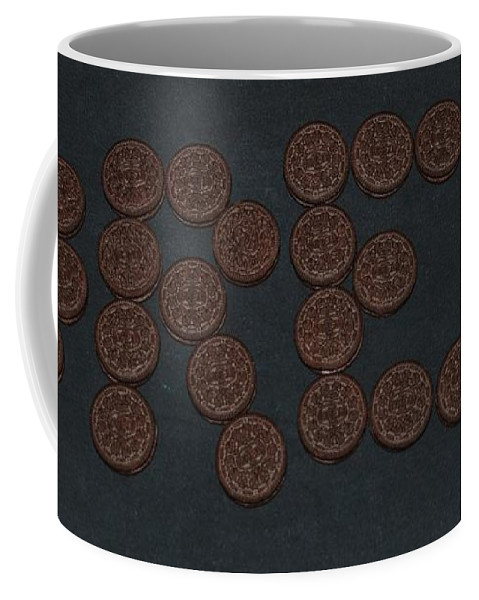 Oreo Coffee Mug featuring the photograph Oreo by Rob Hans