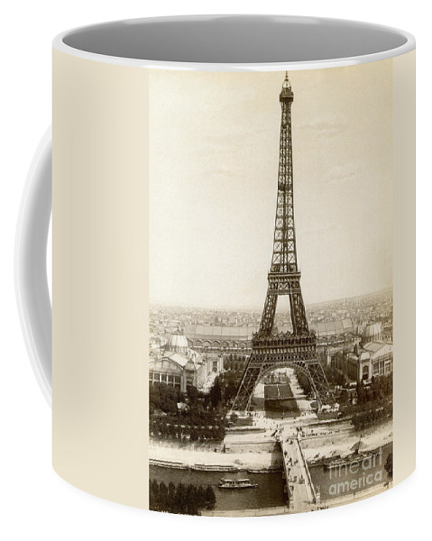 1900 Coffee Mug featuring the photograph Paris: Eiffel Tower, 1900 by Granger