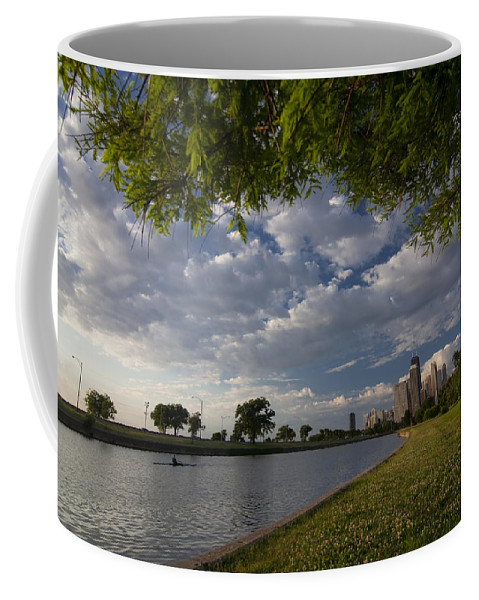 Rowing Coffee Mug featuring the photograph Park Scene With Rower And Skyline by Sven Brogren
