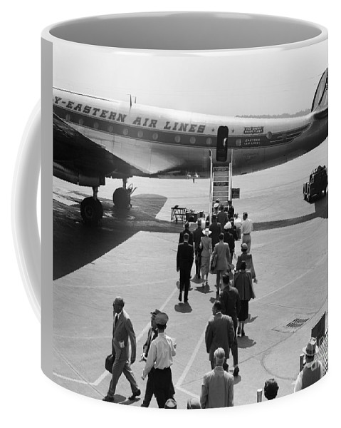 1940s Coffee Mug featuring the photograph Passengers Boarding A Plane by H. Armstrong Roberts/ClassicStock