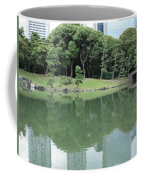 Peaceful Coffee Mug featuring the photograph Peaceful Bridge In Tokyo Park by Carol Groenen