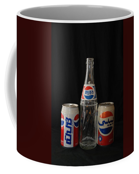 Korean Coffee Mug featuring the photograph Pepsi From Around The World by Rob Hans