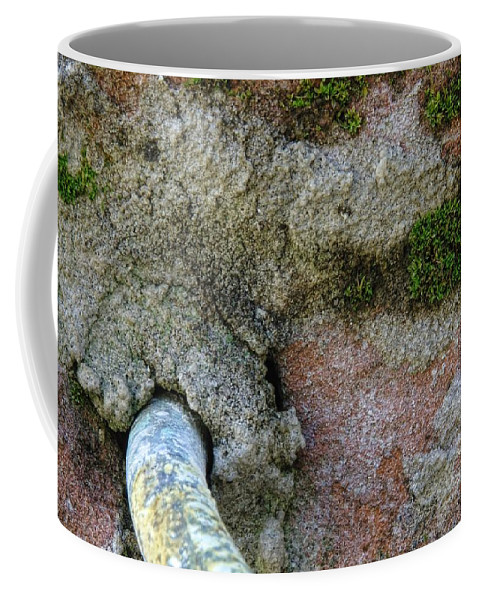 Aging Coffee Mug featuring the photograph Pipe And Brick by Richard Rizzo