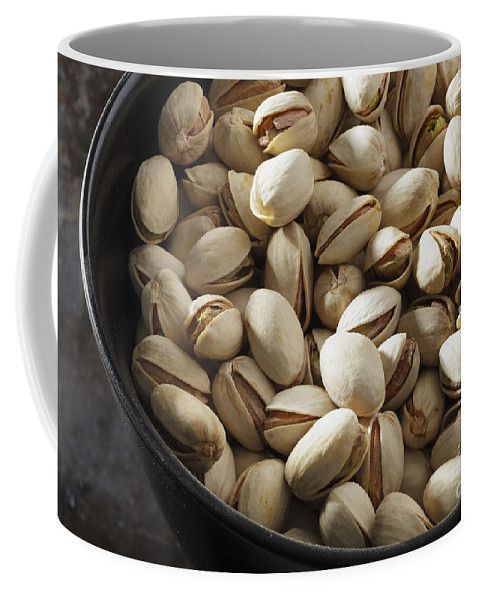 Black Coffee Mug featuring the photograph Pistachio Nuts by Julie Woodhouse