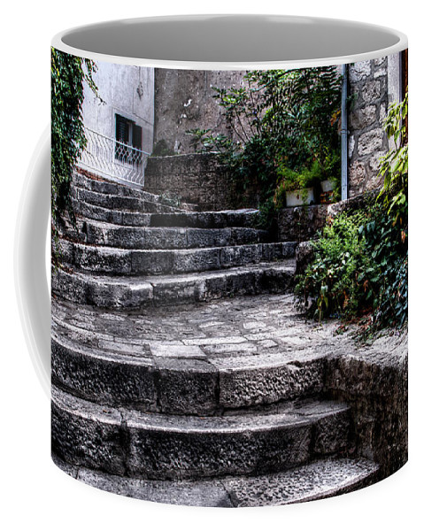 Uneven Stairs Coffee Mug featuring the photograph Plants Grow In The Uneven Stairs Climbing Towards The Tower by Weston Westmoreland