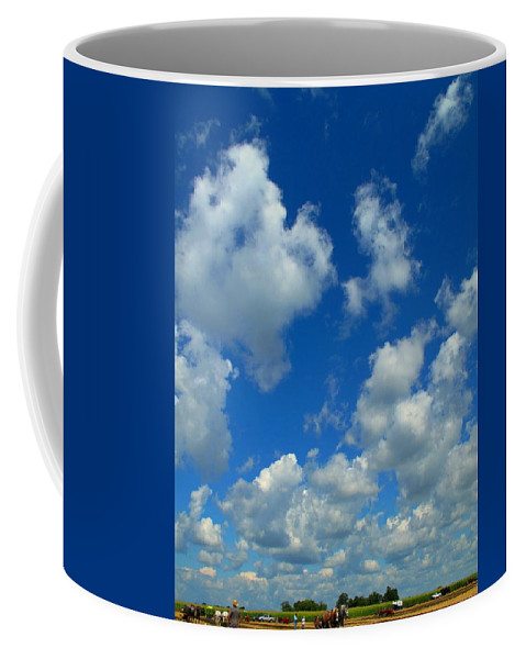Clouds Coffee Mug featuring the photograph Ploughing Under A Mid Day Sun by Ian MacDonald
