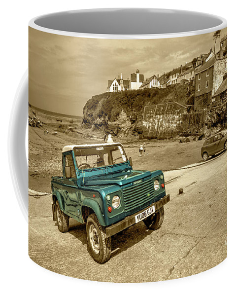 Port Coffee Mug featuring the photograph Port Isaac Defender by Rob Hawkins