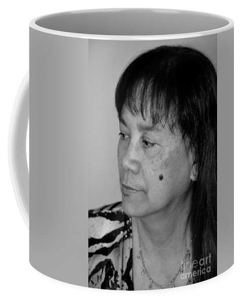 Woman Coffee Mug featuring the photograph Portrait Of An Attractive Filipina Woman With A Mole On Her Cheek by Jim Fitzpatrick