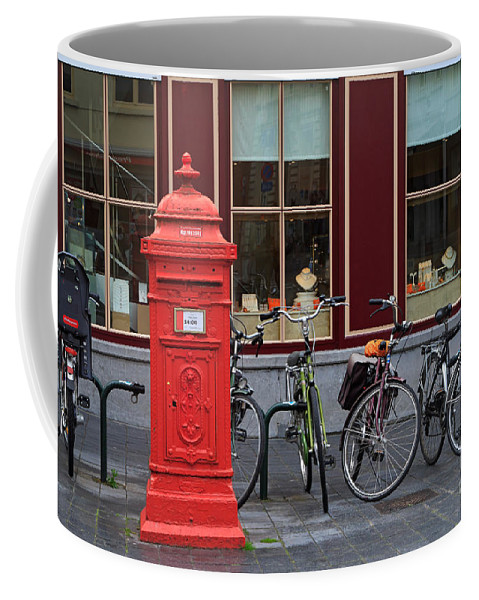 Postbox Coffee Mug featuring the photograph Postbox And Bicycles In Front Of The Diamond Museum In Bruges by Louise Heusinkveld