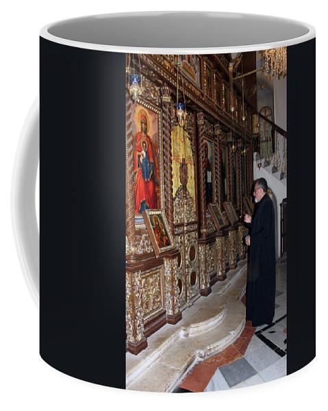 Priest Coffee Mug featuring the photograph Praying In Jericho by Munir Alawi