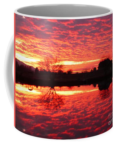Orange Coffee Mug featuring the photograph Dramatic Orange Sunset by Carol Groenen