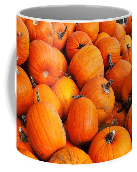 Pumpkin Coffee Mug featuring the photograph Pumpkins by Louise Heusinkveld