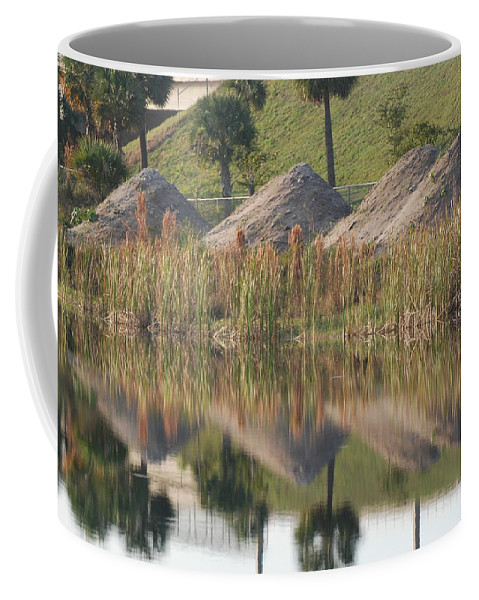 Grass Coffee Mug featuring the photograph Pyrimids By The Lakeside Cache by Rob Hans