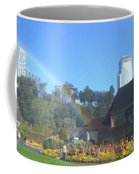 Rainbows Coffee Mug featuring the photograph Rainbow at the Falls by Debbie Levene