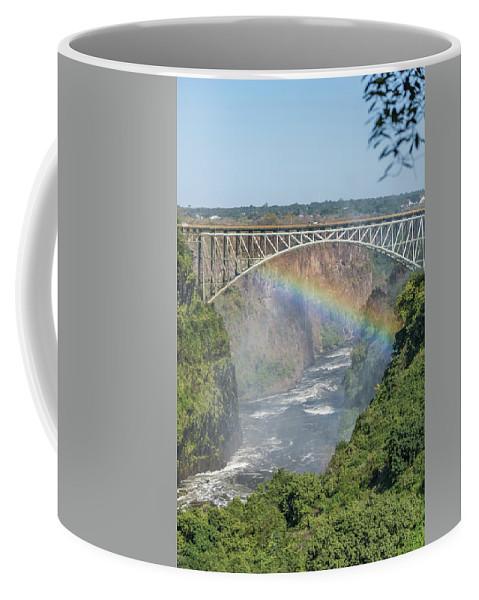 Africa Coffee Mug featuring the photograph Rainbow Crossing Gorge Beneath Victoria Falls Bridge by Ndp
