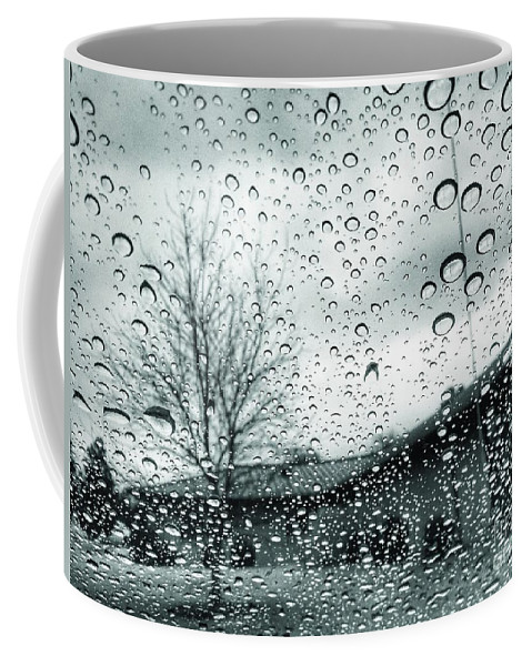 Raindrops On Glass Coffee Mug featuring the photograph Raindrops by John Myers