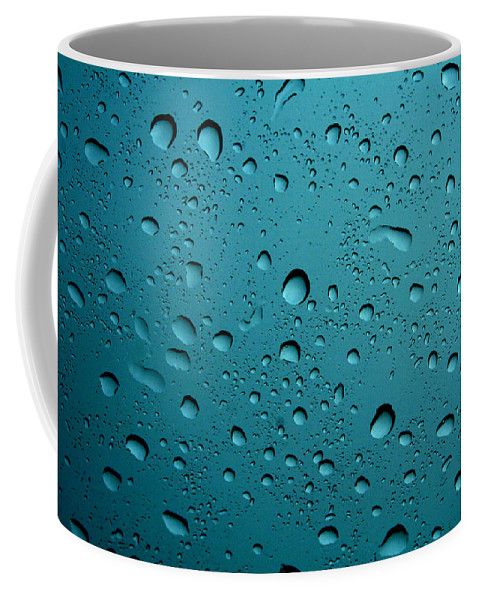 Abstract Coffee Mug featuring the photograph Raindrops by Linda Sannuti