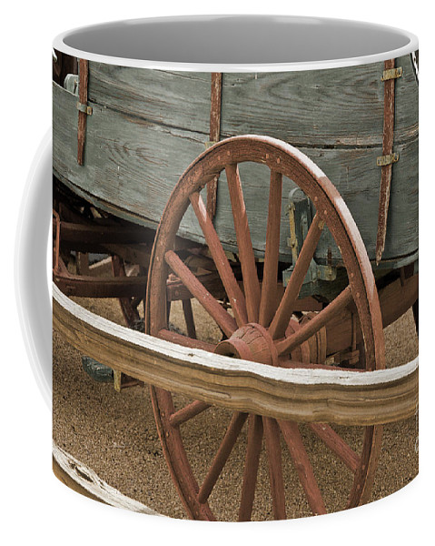 Old West Coffee Mug featuring the photograph Red Wagon Wheel by Kirt Tisdale