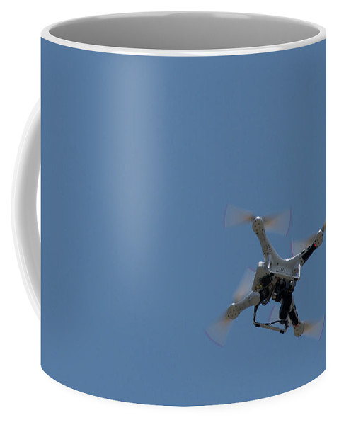 Hong Kong Coffee Mug featuring the photograph Remote Control Drone Helicopter Hovering In Sky by Ndp