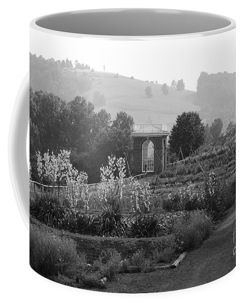 Black And White Coffee Mug featuring the photograph Retreat by Eric Liller