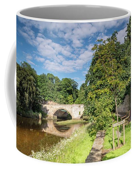 Northumberland Coffee Mug featuring the photograph River Coquet Flows Under Warkworth Bridge by David Head