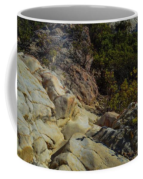 Rock Coffee Mug featuring the photograph Rock Climbing by Miranda Strapason