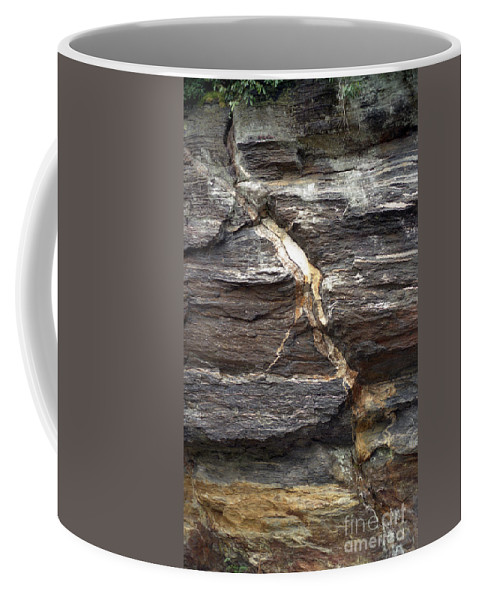 Rock Face Coffee Mug featuring the photograph Rock Face by Richard Rizzo