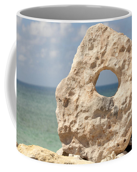 Arrangement Coffee Mug featuring the photograph Rock With A Hole With A Tropical Ocean In The Background. by Anthony Totah