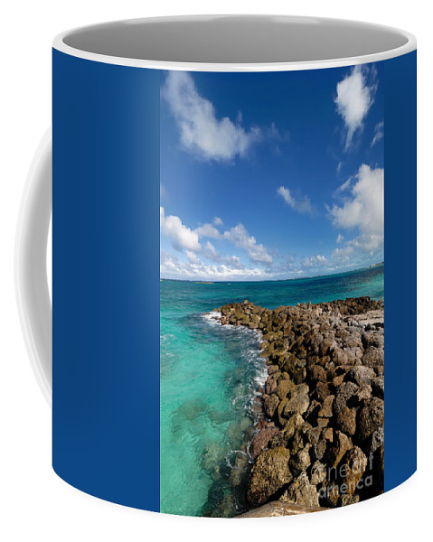 Atlantic Ocean Coffee Mug featuring the photograph Rocky Shoreline On The Beach At Atlantis Resort by Amy Cicconi