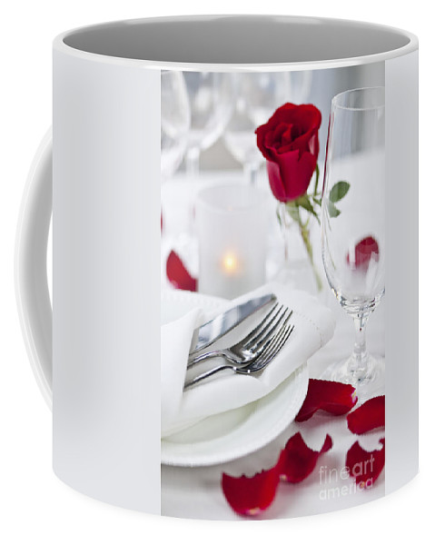 Romantic Coffee Mug featuring the photograph Romantic Dinner Setting With Rose Petals by Elena Elisseeva