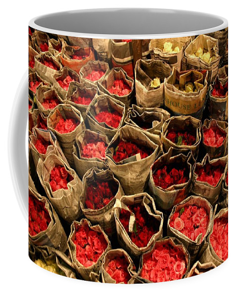 Roses Coffee Mug featuring the photograph Rose Rolled In Newspaper by Minaz Jantz